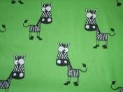 Zebras grün/ € 16,- pro lfm./ 100% CO / 160 cm breit